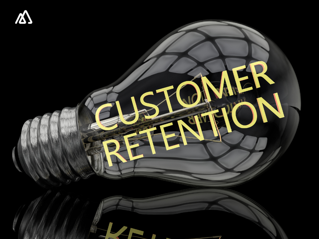Bulb with customer retention written on it on a black background