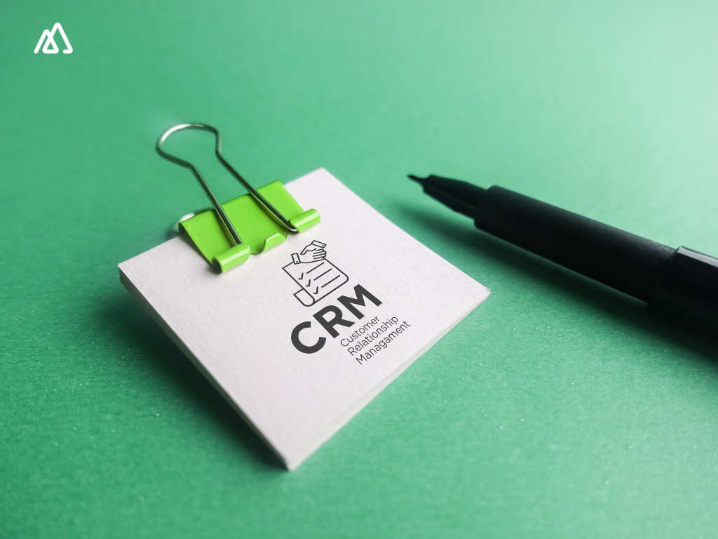 green bg and sticky note with CRM written on it