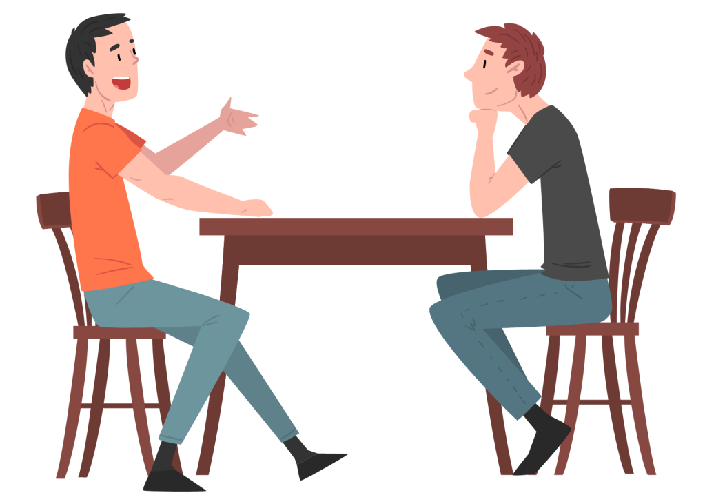 Two people at a coffee table