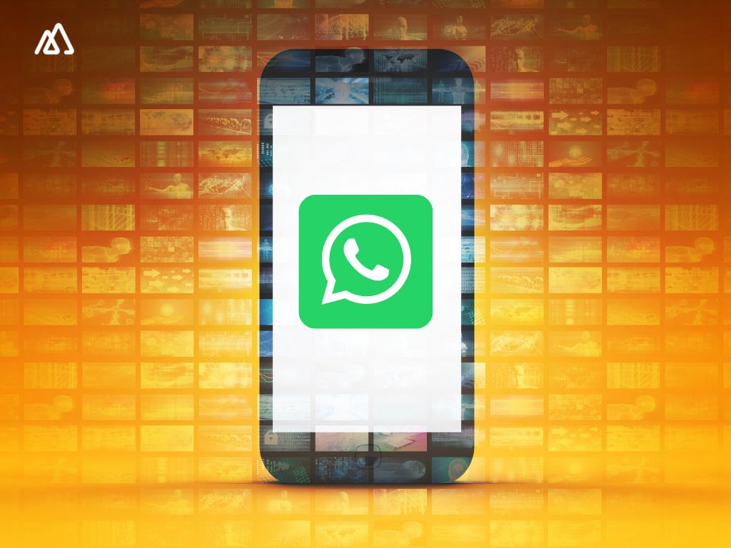 mobile with whatsapp logon on orange background